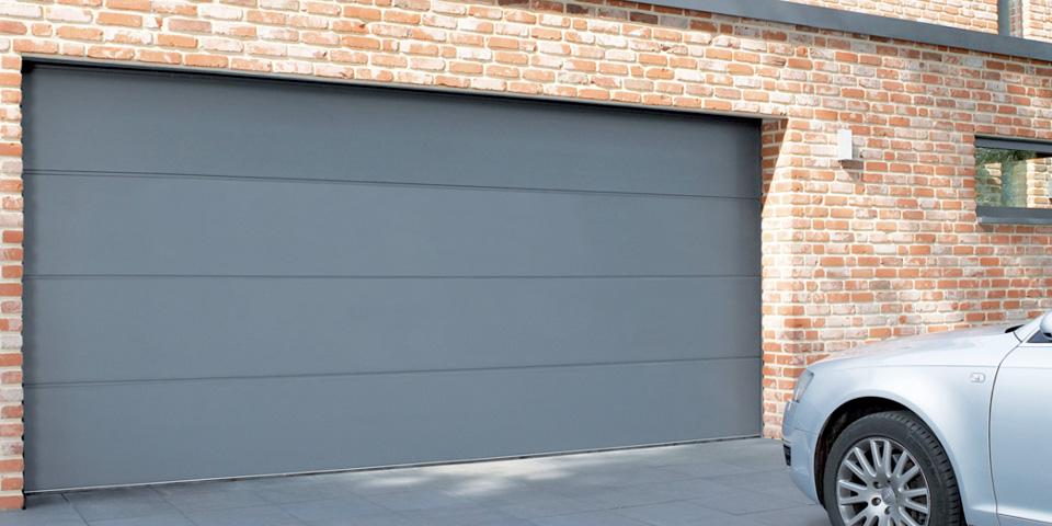 portes de garage sectionnelle la pose d 39 eric haut rhin. Black Bedroom Furniture Sets. Home Design Ideas